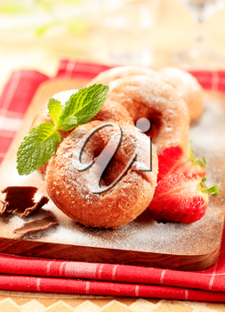 Ring doughnuts sprinkled with icing sugar