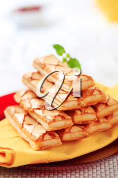 Stack of apricot glazed puff pastries on a plate
