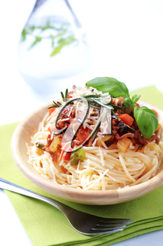 Spaghetti and meat-based sauce sprinkled with cheese
