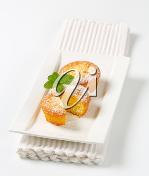 Custard filled muffins on plate