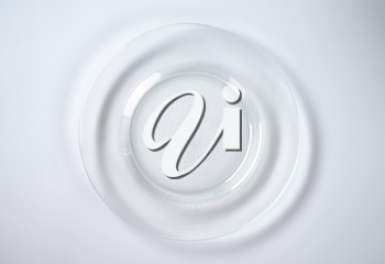 empty glass plate with wide rim
