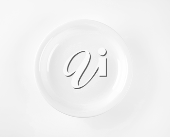 coupe shaped soup plate on white background