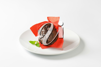 Double chocolate cupcake wrapped in red paper