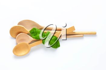 variety of wooden spoons on off-white background