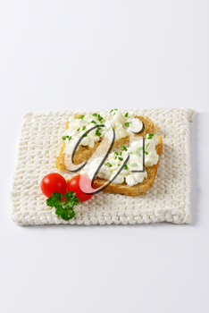 bread with cottage cheese and chives on white mat