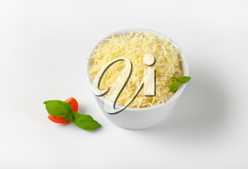 bowl of grated parmesan cheese