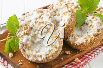 Small apple crumble cakes sprinkled with sugar