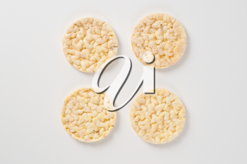 slices of puffed rice bread on white background
