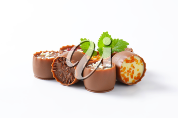 Delicate milk chocolate cups with liqueur and ganache centres