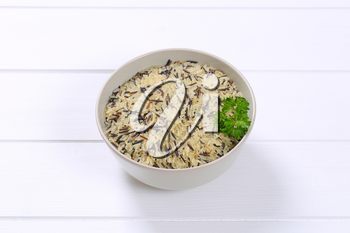 bowl of wild rice on white wooden background