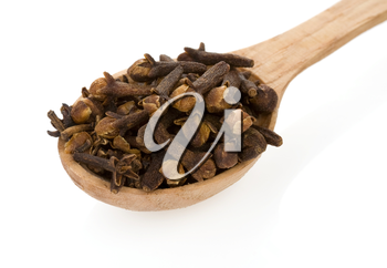 clove spices in spoon isolated on white background