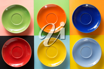 empty saucer at abstract colorful background
