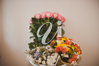 The wedding bouquet lies on a table.