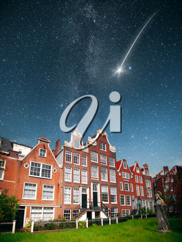 At night, under the light of stars. falling star. Amsterdam. historical monument begijnhof