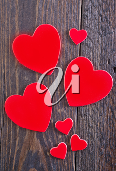 red hears on the wooden table, hearts on wood