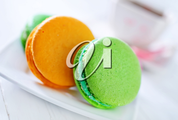 macaroons on plate and on a table