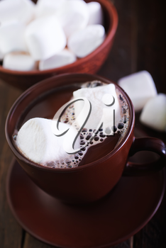 cocoa drink with marshmellow on the wooden table