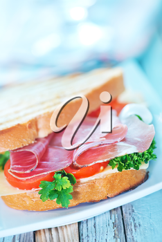 sandwich with ham and vegetables on the plate