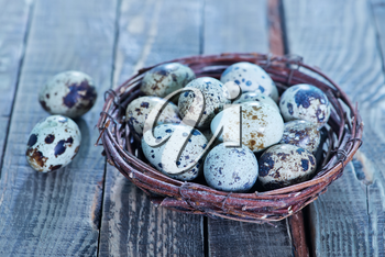 quail eggs in the nest and on a table