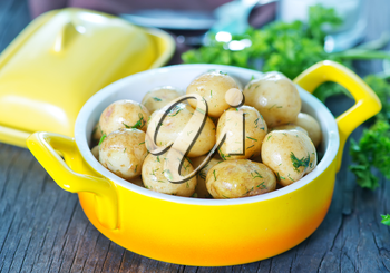 boiled potato in bowl and on a table