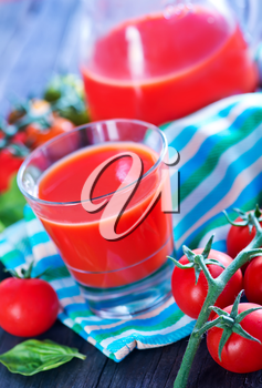 tomato juice in glass and on a table