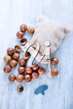 macadamia on a table, nuts in bag and on a table