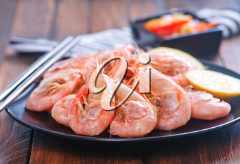 shrimps on plate and on a table