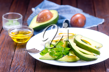 avocado salad on white plate and on a table