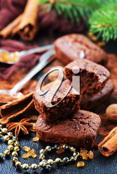 chocolate cake with spice on christmas background