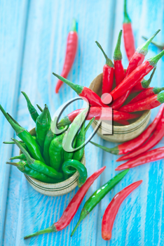 green and red chilli peppers on a table