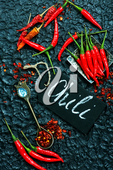 chili peppers on the black table