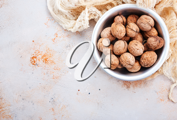 walnuts in bowl and on a table