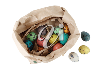 Colored quail eggs in a package of brown paper on white background. Isolated with clipping path. Top view.