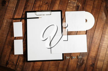 Blank stationery set on wooden table background. ID template. Mock up for branding identity for designers. Responsive design mock-up. Top view.