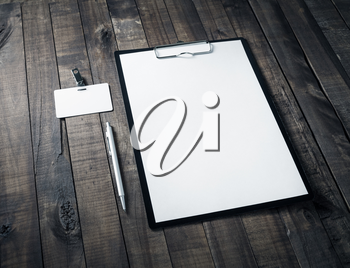 Blank letterhead, badge and pen on wooden table background. Mock up for ID. Blank template for branding identity for designers.