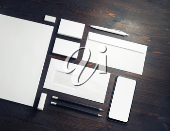 Photo of blank corporate stationery set on wooden background. Corporate ID template. Responsive design mockup.