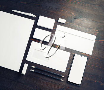Blank corporate stationery set on wood table background. Branding mock up. Template for placing your design.