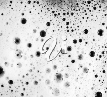 Foam with bubbles. Soap sud. Abstract background. Shampoo in water. Flat lay