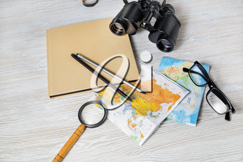 Travel plan background. Ready for the trip. Map, book, magnifier, binocular, pencils and glasses.