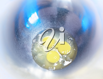 Three eggs on the cooking plate background hd
