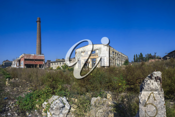 Old abandoned industrial factory Krayan in Odessa, Ukraine, in a sunny summer day