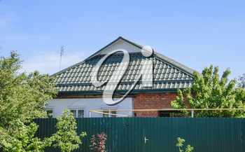 The roof of corrugated green sheet. Roofing of metal profile wavy shape.