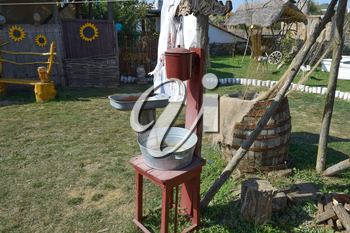 Washbasin with a basin in the yard. The old way of life in the village.