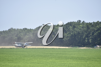 Aircraft agricultural aviation AN-2. Landing on the field for filling fertilizers An-2.