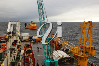 Deck of the pipelaying vessel. Pipelaying barge.