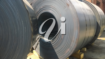 Steel sheets rolled up into rolls. Export Steel. Packing of steel for transportation.