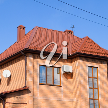 Decorative metal tile on a roof. Types of a roof of roofs. Decorative metal on the roof of the house.