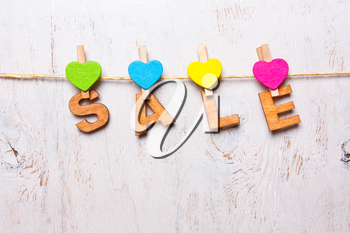 the word sale of wooden letters on a white background
