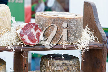 The Italian sliced ham and cheese for sale is on the counter the street market.