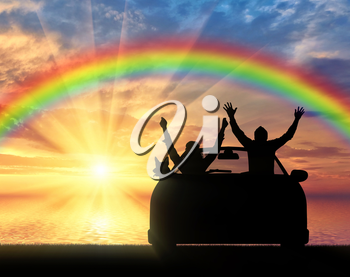 Travel and freedom. Happy people in the car with the dog on the sea sunset and rainbow